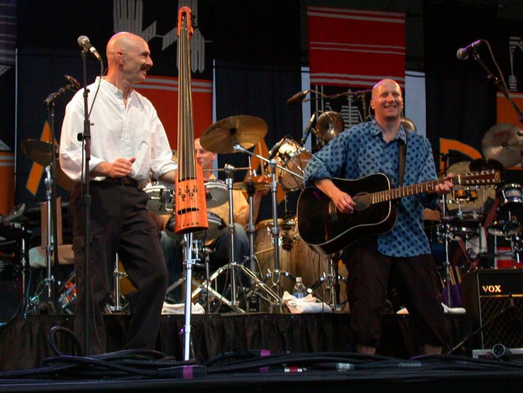 Tony Levin, Ged Lynch, and David Rhodes with Peter Gabriel at WOMAD 2001, photo by Danette Davis