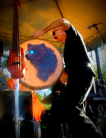 Tony Levin playing a drum