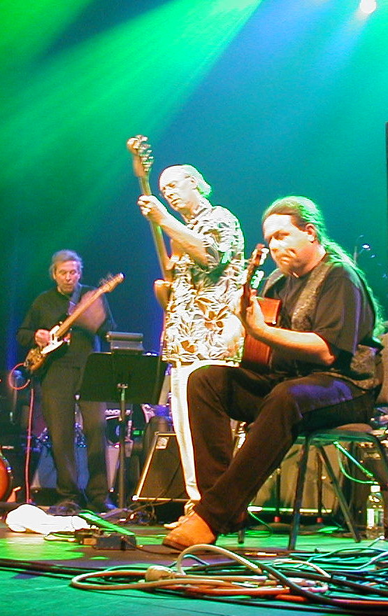 Phil Miller (L) on stage with Richard Sinclair and Fred T Baker at Progman 2003
